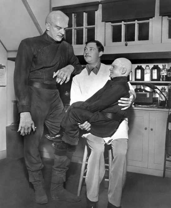 THE THING FROM ANOTHER WORLD, from left: James Arness, make-up artist Lee Greenway, Billy Curtis, on-set, 1951
