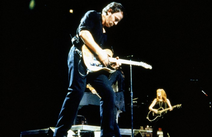 BRUCE SPRINGSTEEN performing in the 'Concert for New York', with wife Patti Scialfa in rear, 2001