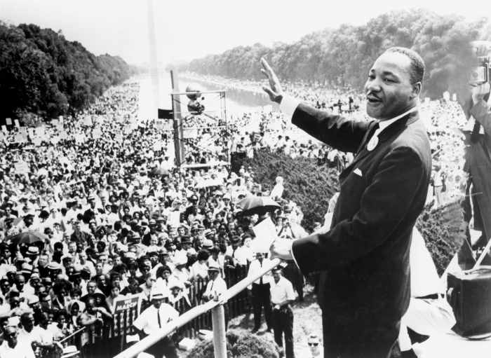 DR. MARTIN LUTHER KING, JR. joyously addresses a mass audience in Washington, DC, 1963