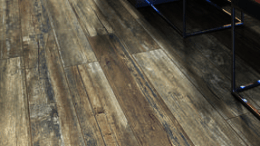 Porcelain tiles, such as the Boardwalk Series in the Coney Island color from Mediterranea, allow restroom designers to integrate the look of wood in a water-friendly and easily cleanable surface. PHOTO: Mediterranea