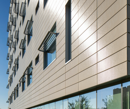 Telling Architectural Systems has announced broad-based North American availability of in-house, custom glazing for its Argeton terracotta tile rainscreen cladding.