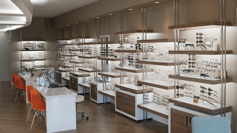A custom LED strip lighting solution ensures eyeglasses and sunglasses are consistently illuminated throughout the display area.