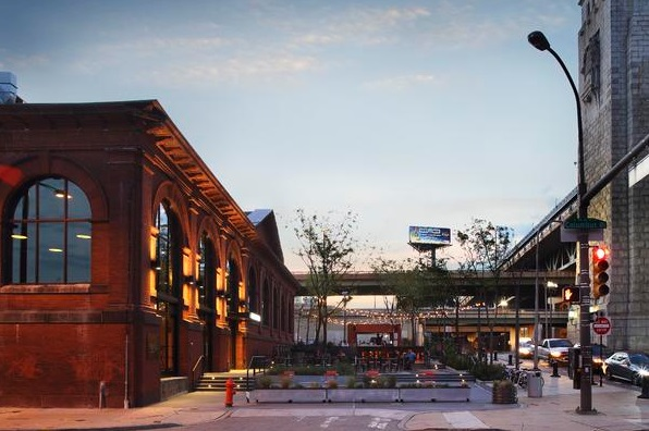 The 10,000-square-foot FringeArts building, a former firehouse pumping station on Philadelphia's Delaware River waterfront, now is La Peg, a French brasserie. The project team took advantage of the closed-to-traffic area of Race Street to add an outdoor plaza off the restaurant.