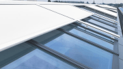 VELUX and RENSON have introduced Topfix VMS, a motor-operated sunscreen with special mounting feet engineered for fixed and movable VELUX Modular Skylights.