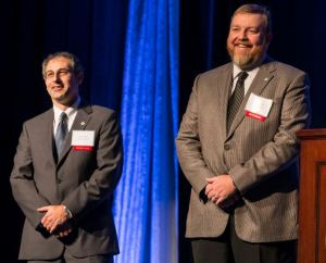 Steve Tice and Chet Sears accept the Manufacturing, Wholesale & Distribution award on behalf of Johnson Controls.
