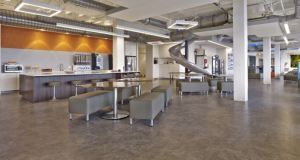 The stainless steel slide is a focal point in the SevOne office.