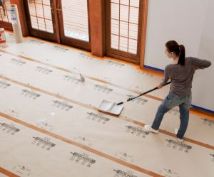 Floor protection board keeps spilled paint and other liquids from damaging floors and other surfaces.