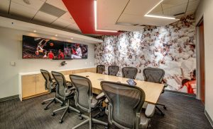 V Three Studios brings the college sports atmosphere to the Learfield headquarters renovation through televisions displaying sports programming, sports themed wallcoverings and recycled stadium seating.