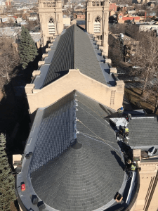 Horn Brothers Roofing installs 245 squares of composite slate tiles on Saint John's Cathedral in Denver.