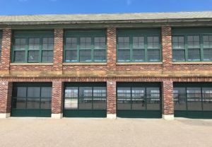 Aluminum garage doors from Haas Door are retrofit into all of the openings of the historic structure.