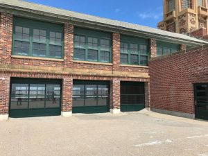 Renovations at the Riis Park Bathhouse called for elements of flow-through design, including roll-up doors, to make the historic property more resilient to future storms.