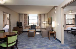 The extended-stay hotel looks more like an urban apartment building with exposed brick and timber and existing hardwood floors.