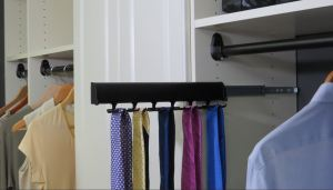 Vertical storage of ties, belts, and scarves clears up cluttered areas and allows residents to categorize their wardrobe accessories.
