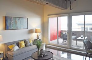 Each one-bedroom apartment, which ranges in size from 650 to 670 square feet, features polished concrete floors and concrete walls.