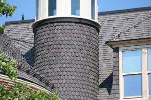 Three of Old Main's four towers are now covered with diamond shingles from DaVinci.
