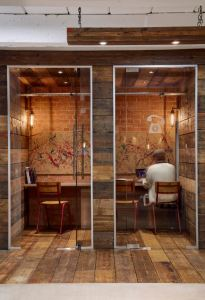 Gensler created coworking space for Cherryduck Studios, London, and weaved the history of the building into the design elements, including the phone booths.