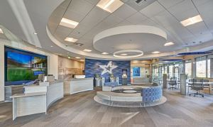 Rockfon Artic acoustic stone wool ceiling panels and Chicago Metallic suspension systems accomplish the aesthetic and functional needs of the project.