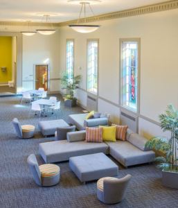 TAT embraced the vibrant colors of the community room's large stained-glass windows and reflected them in the space's finishes and furnishings.