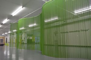 The partition separates the entrance from storage areas, while also providing path guidance for occupants.
