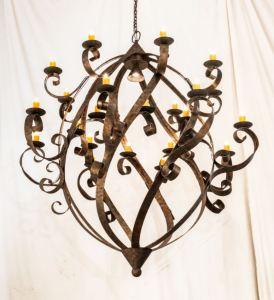 The Caliope Chandelier is 80 inches wide and adorned with 24 Amber faux candlelights.