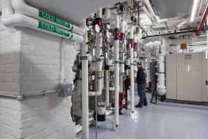 The geothermal system's pumps and compressors are located in a former boiler room in the basement and controlled by a building management system.