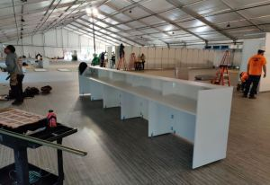 Tafisa white melamine panels are used to fabricate nurse's stations and tables at a temporary hospital set up at SUNY Old Westbury, N.Y.
