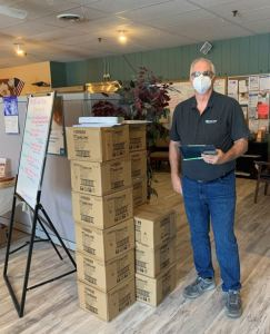 Stan Mertz, vice president of utility and residential programs, delivers LED bulbs on behalf of MaxLite and Mass Save to the WHEAT Community Services food pantry in Clinton, Mass.