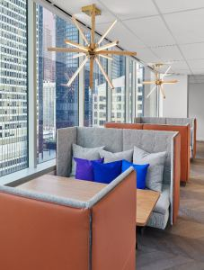 A centrally placed cafe serves as a place for large gatherings or informal meeting areas for employee brainstorms or team debriefs.