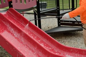 D7 antimicrobial disinfectant is applied to playground equipment at the Dunklin R-5 Taylor Early Childhood Center.