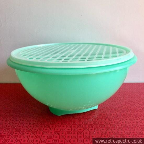 Green vintage tupperware colander