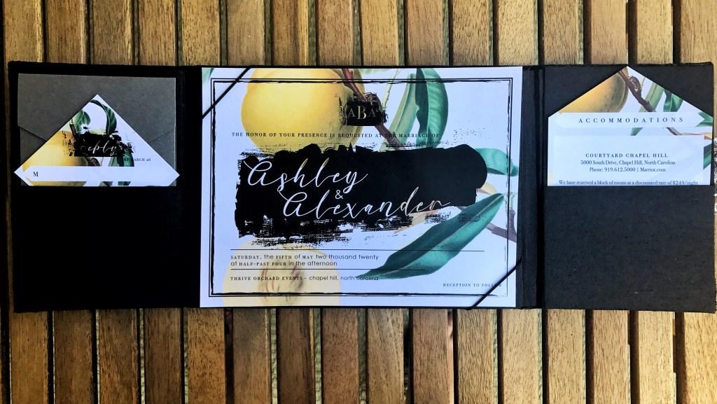 vintage botany wedding invitation in black velvet folio