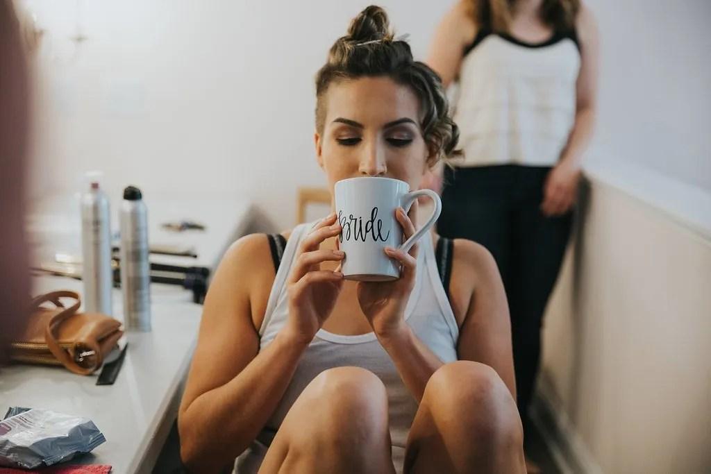 Bride drinks coffee | revelry + heart | wedding regrets