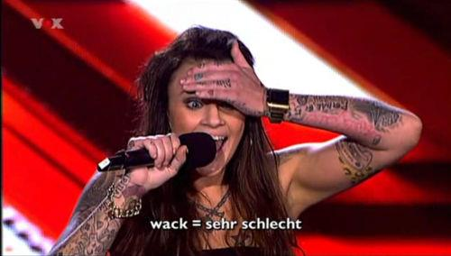 Television screenshot translating 'wack' for German viewers.