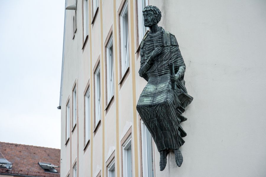 A statue on the side of a building in Nuremberg, Germany.