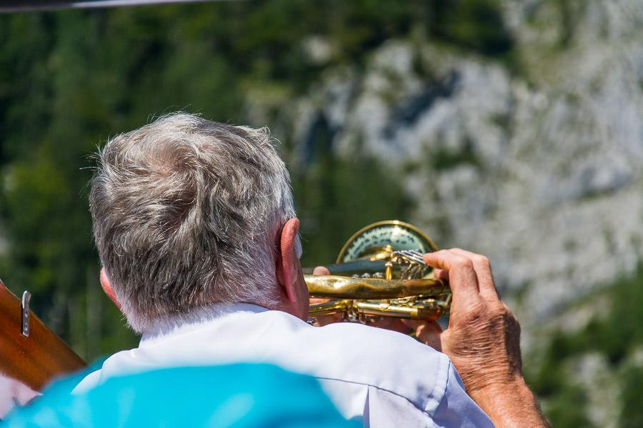 A trumpet player demonstrates the echo off the Watzmann in Berchtesgaden.