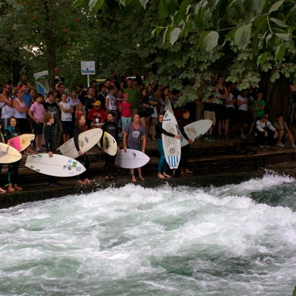 Watch surfers on the Eisbach in Englischer Garten during 24 hours in Munich Germany.
