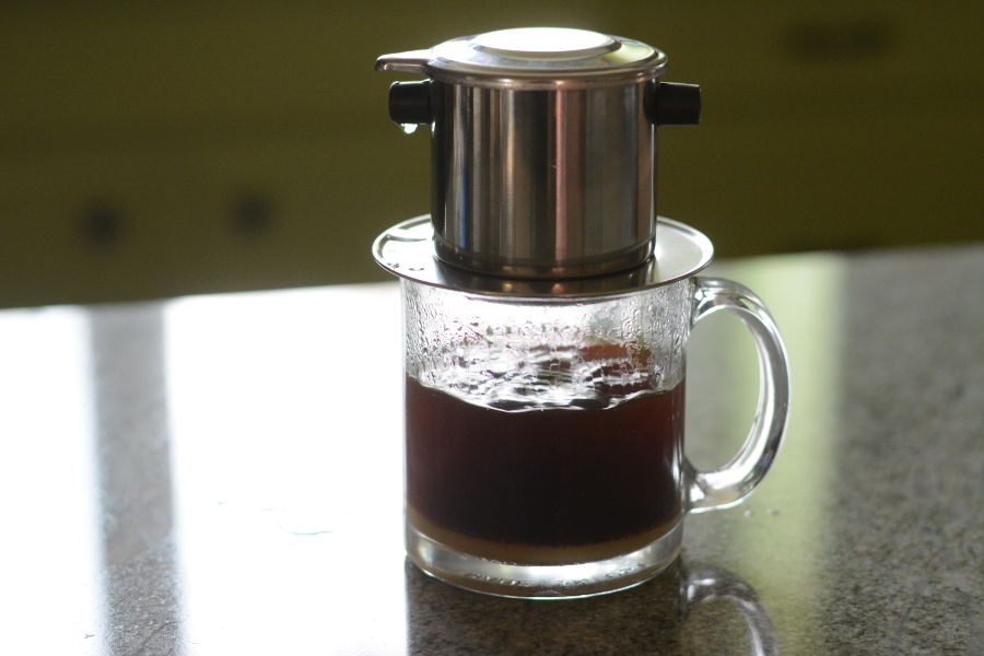 A Vietnamese Phin or filter brewing coffee.