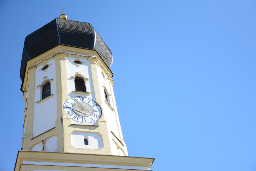 The tower of the St Andreas Church in Aying, Germany.
