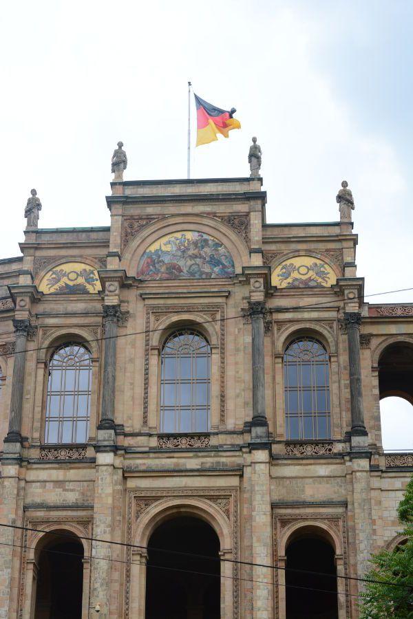 A German flag flies over the Maximilianeum.