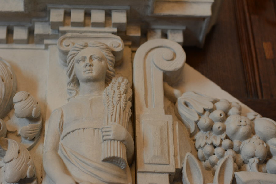 Details on a fireplace mantel in Nemours Mansion.