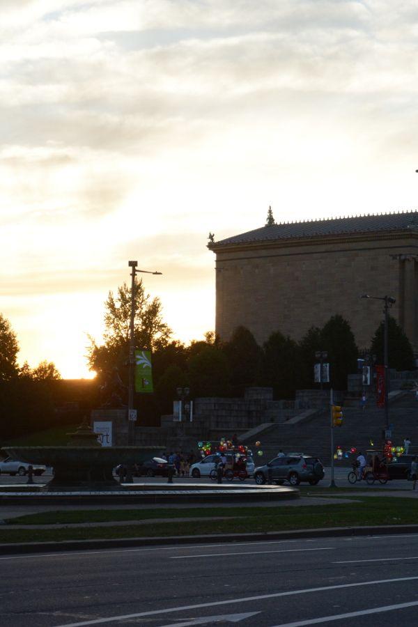 Cai Guo-Qiang: Fireflies pedicabs glide past the Philadelphia Museum of Art.