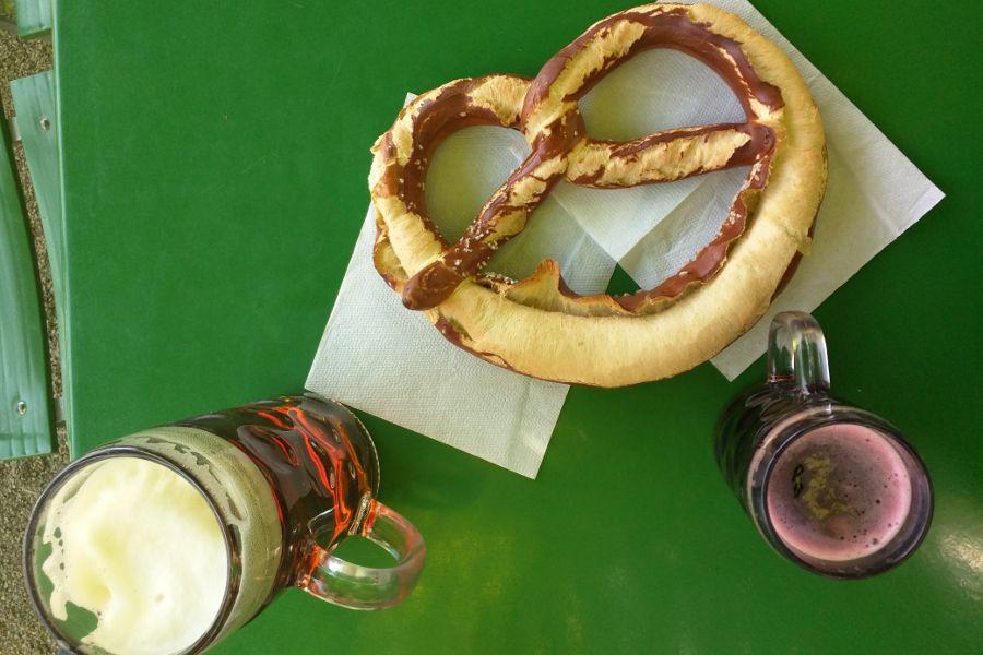 A giant pretzel, beer and Johanisbeer Shorle at Munich's Chinesischer Turm in Englischer Garten.