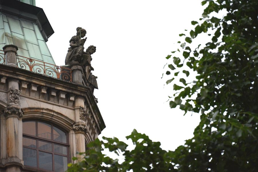 Figures on top of a building in Hamburg, Germany.