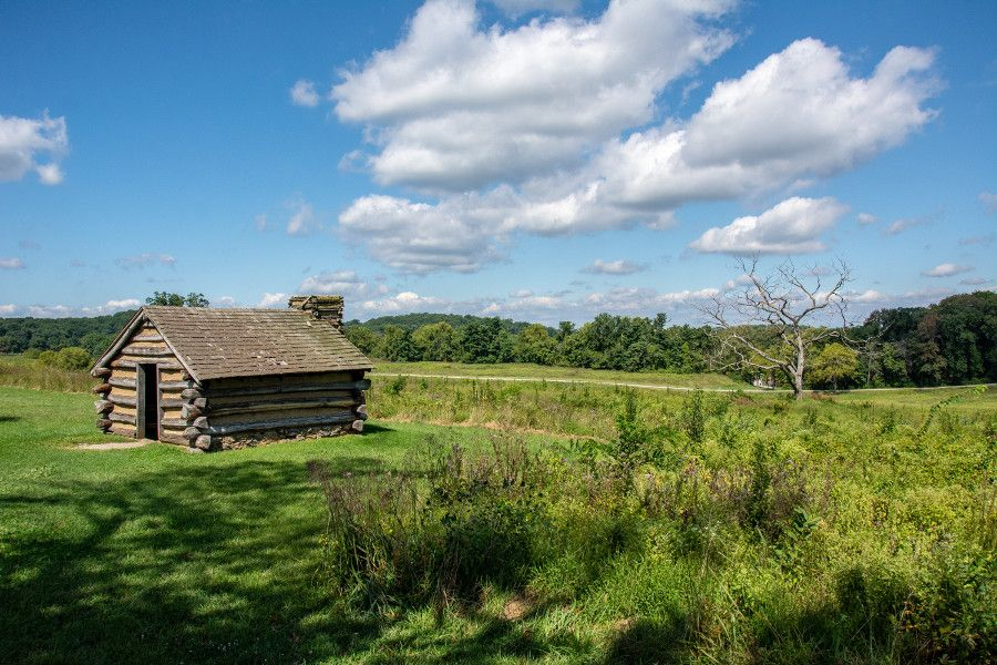 A log cabin in a meadow at Valley Forge National Historical Park.