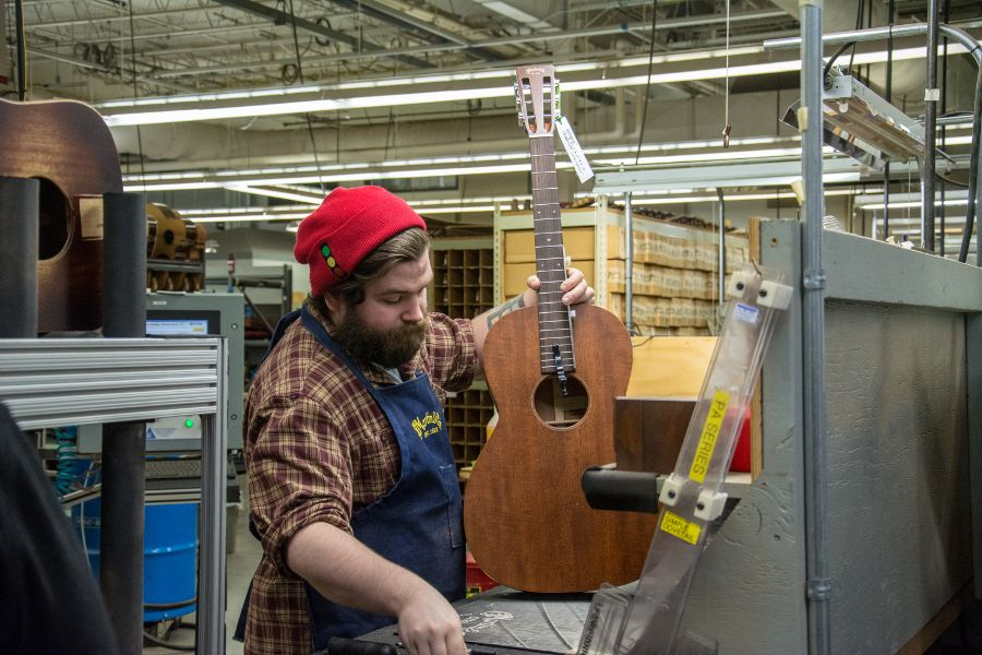 Attaching guitar necks and bodies at Martin Guitar factory.
