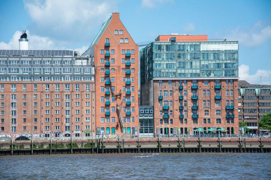 Brick buildings along waterfront in Hamburg, Germany.