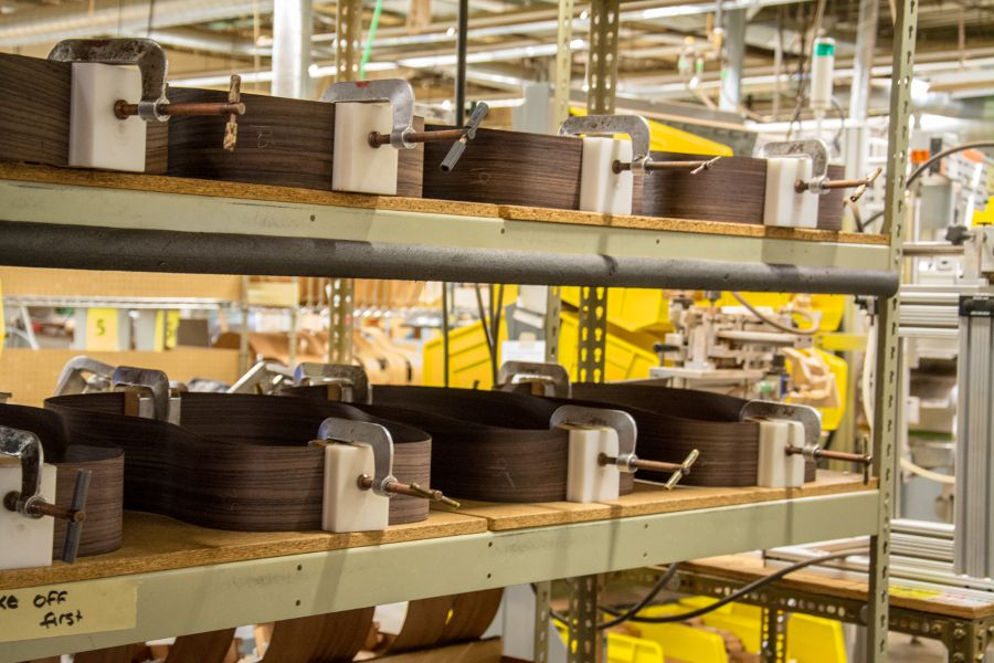 Clamped guitar bodies at the Martin Guitar factory.