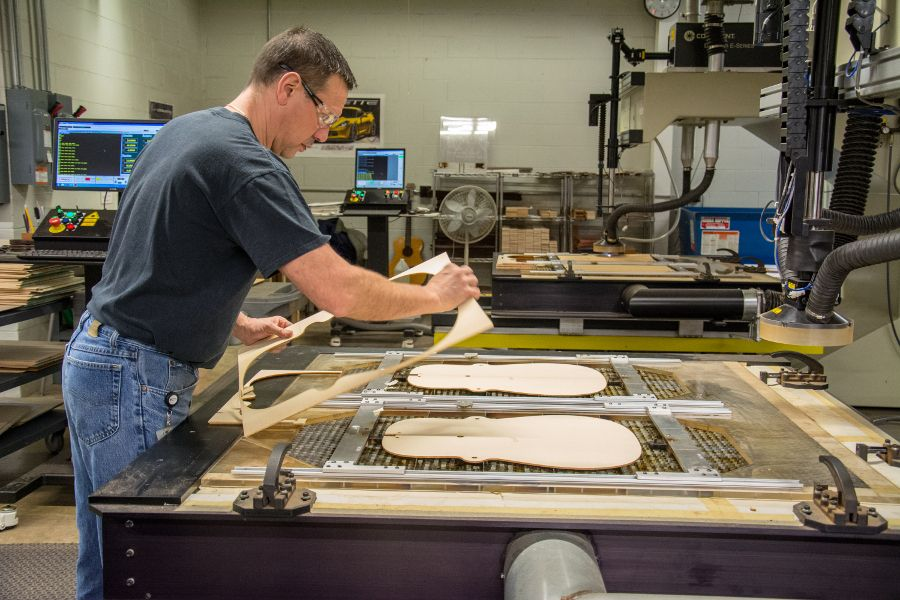 Cutting out guitar bodies at the Martin Guitar factory.