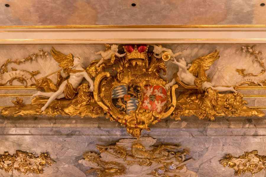 A royal crest hiding in the lavish decoration at the Cuvilliés Theatre in Munich, Germany.