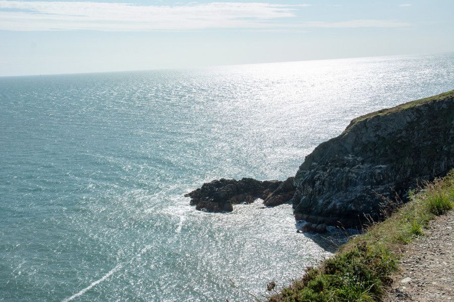 The side of the Howth cliff along the sparkling Irish Sea in Ireland.